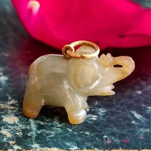 Tiny vintage carved stone elephant pendant
